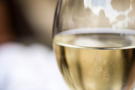 al fresco: Close Up Of A Glass of White Wine With Copy Space