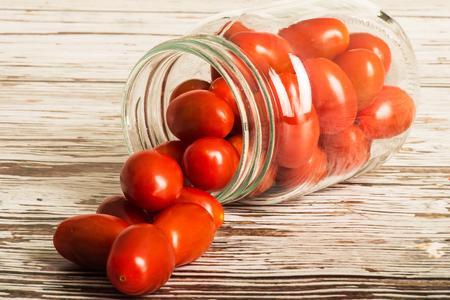 plumb: Glass Jar of Fresh Ripe Uncooked Plumb Tomatoes