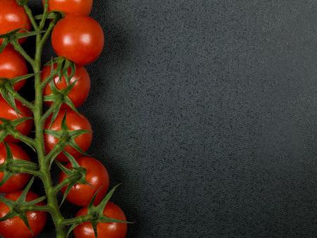 grown: Vine Grown Organic Cherry Tomatoes Stock Photo
