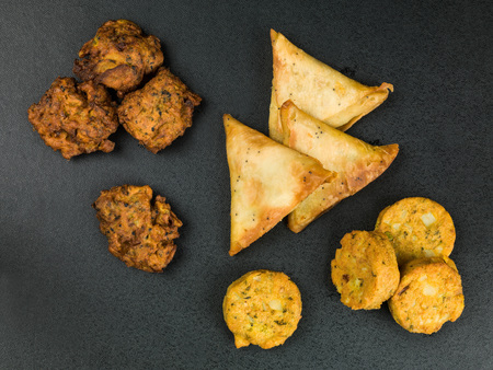 Indian Snack Selection Samosas Onion Bhagi And Aloo Tikkis Finger Food