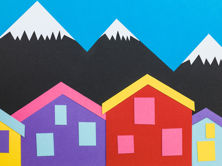 Illustration of a Mountainous Background Scene With Chalets or Cabins In The Foreground Stock Photo