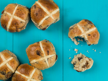 Easter Hot Cross Buns Against a Blue Background Stock Photo