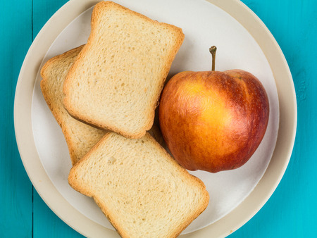 Fresh Apple With French Toast Against a Blue Background