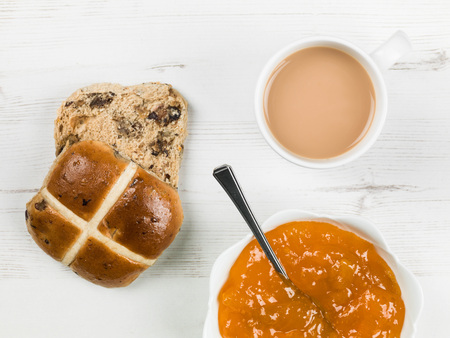 Toasted Hot Cross Bun With Tea and Apricot Jam