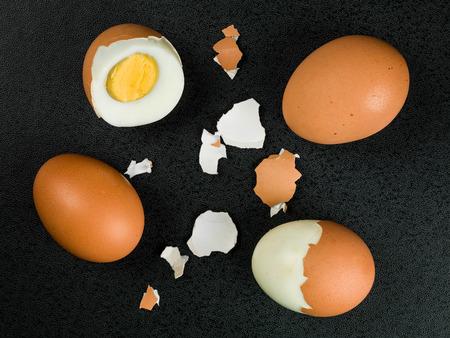Four Fresh Hard Boiled Eggs Against a Black Background