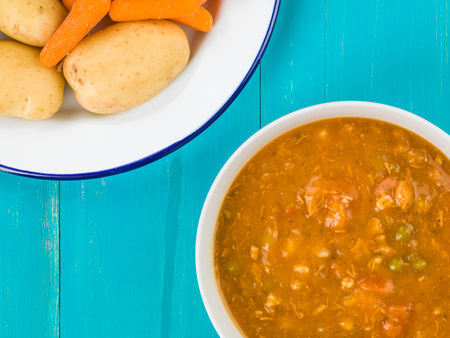 favorite soup: Chunky Vegetable and Chicken Soup Against a Blue Wooden Background
