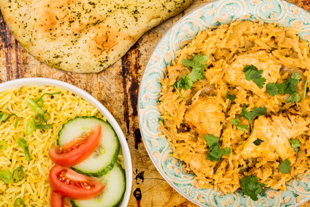 Indian Style Chicken Biryani Curry With Rice On A Distessed Oven or Baking Tray