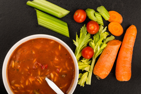 Bowl of Fresh Italian Style Minestrone Soup Against a Black Background Фото со стока