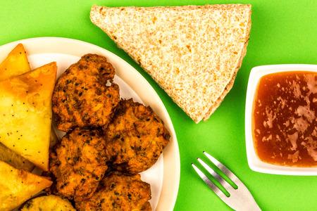 Indian Food Style Snacks Vegetarian Tikka Vegetarian Samosa Onion Bhaji With Chapati Flat Bread Against A Green Background Stock Photo