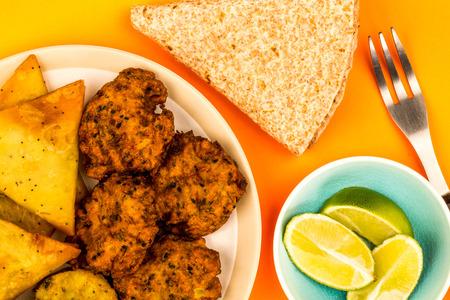 Indian Food Style Snacks Vegetarian Tikka Vegetarian Samosa Onion Bhaji With Chapati Flat Bread Against An Orange Background Stock Photo