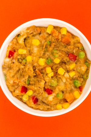 Traditional Shepherds Pie And Vegetables Served In A Bowl With Sweet Corn And Red Peppers