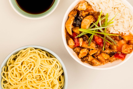Cantonese Style Sweet And Sour Chicken With Rice Against A Grey Background