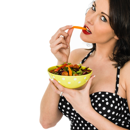 Woman Holding A Bowl Of Fresh Mixed Garden Salad Wearing A Polka Dot Summer Beach Top Isolated Against A White Background With Copy Space