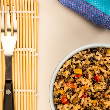 Healthy Vegetarian Or Vegan Meal Of Rice And Quinoa Against A Grey Background