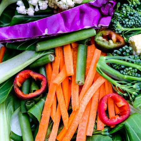 Selection of Healthy Raw Vegetables including carrots pak choi broccoli, chilli and red cabbage