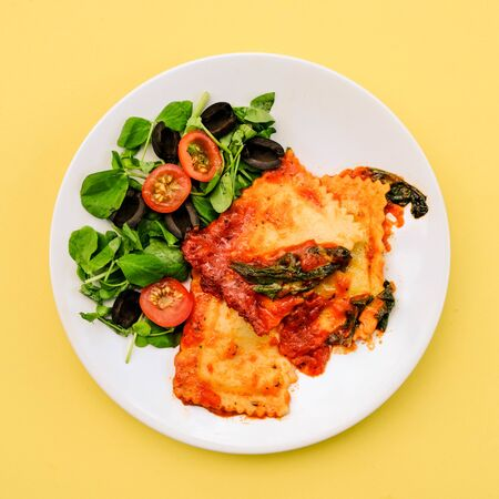 Italian Style Spinach and Ricotta Ravioli Meal With Black Olives anda Green Salad