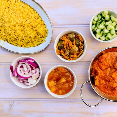 Indian Style Butter Chicken Curry and Pilau Yellow Rice