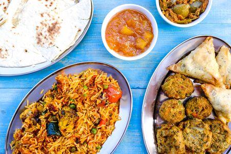 Indian Style Vegetable Biryani Meal With Pakoras, Samosas and Onion Bhajis