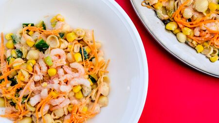 Healthy Mediterranean Style Prawn and Pasta Salad With Sweetcorn and Sauce on a Plate