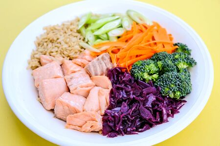 Fresh Healthy Salmon Poke Bowl With Broccoli, Carrots, Wholegrain Rice and Spring Onions