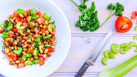 Fresh Healthy Vegetarian Mixed Bean Summer Salad With Celery, Tomatoes and Parsley