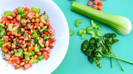 Fresh Healthy Vegetarian Mixed Bean Summer Salad With Celery, Tomatoes and Parsley Archivio Fotografico