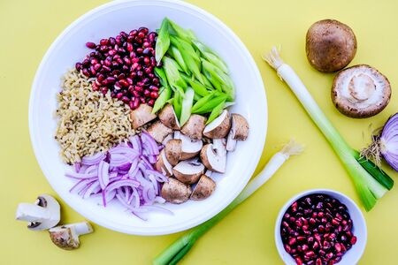 Vegetarian Mushroom and Rice Poke Bowl, With Chestnut Mushrooms, Pomegranate Seeds, Spring Oniond and Red Onions