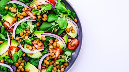 Healthy Vegetarian or Vegan Avocado and Lentil Salad, With Red Onions, Green Salad Leaves andcopy space,  Cherry Tomatoes