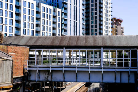 London, May 31, 2020, Modern Developmment Of Luxury New Build Apartments Against An Old Traditional Railway Bridge Finding It Hard To Secure Sales and Rentals