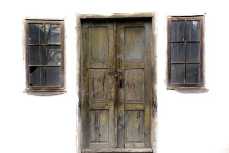 guard house: Door and two windows on an old abandoned house Stock Photo