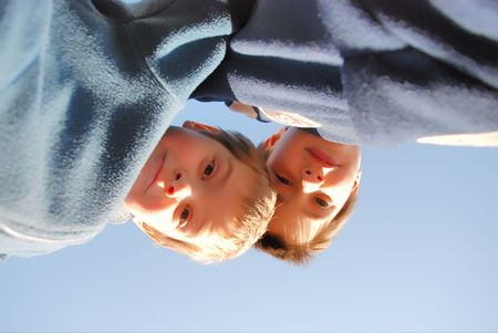 two boys looking down photo