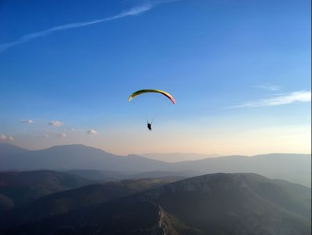 Paraglider in a twilight