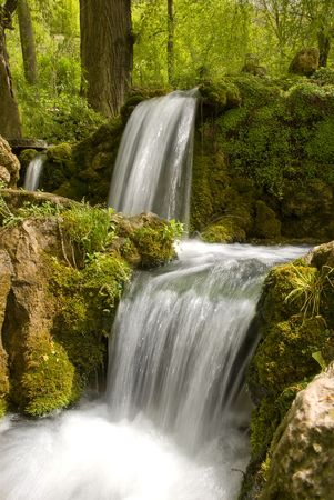 small waterfall with a clear drinking water