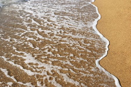 sea wave on a wet sand Stock Photo - 3338420