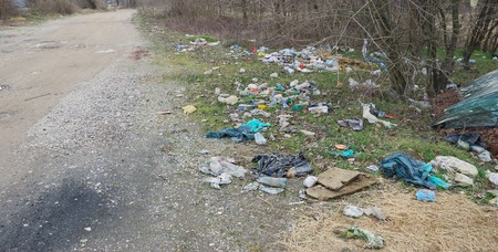 beside: Trash beside the road polluting environment Stock Photo