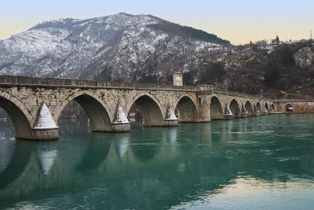The bridge on the Drina in Visegrad in Bosnia and Herzegovina in twilight photo