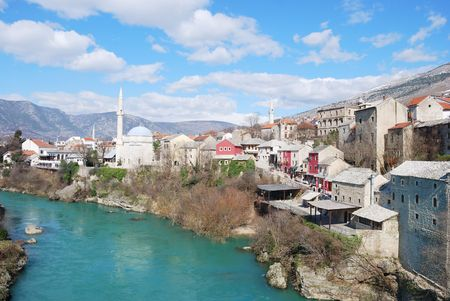 Famous touristic place Mostar viewed from The Old Bridge