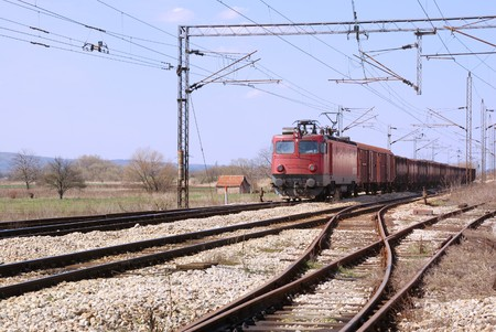 goods train: Red old train on a railroad passing by.