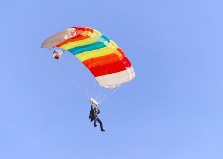 Colorful parachute against clear sky in background. Stock Photo