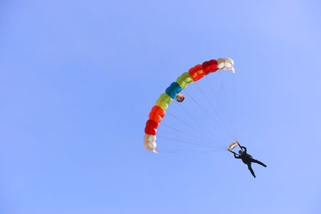 Colorful parachute against clear sky in background. 免版税图像
