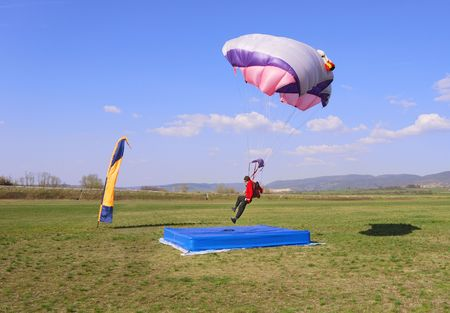 Parachutist landing right in the center of a target.