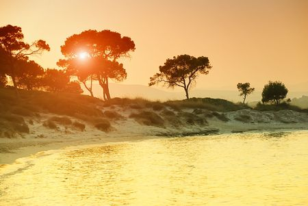 Sunset over Vourvorou beach, Sithonia, Chalkidiki, Greece.