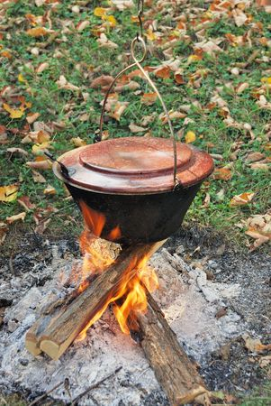 caldron: Traditional way of preparing food in a caldron hanging over fire.