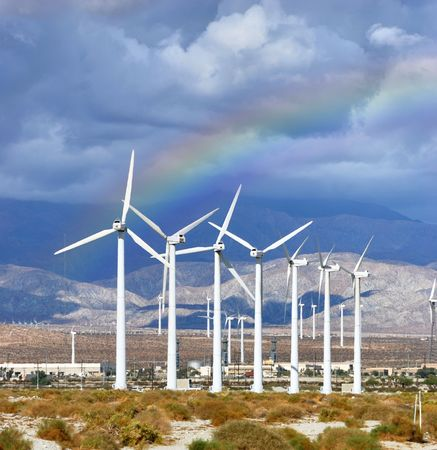 Windmills rotating and producing clean energy, electric power.