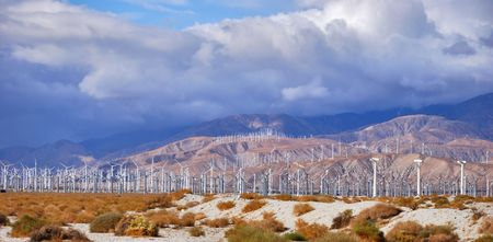 Windmills rotating and producing clean energy, electric power. photo