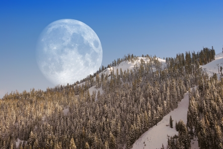 Big Moon over mountain in afternoon light.