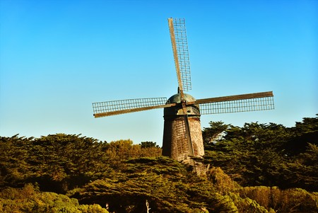 Windmill near San Francisco lit by afternoon sun. photo