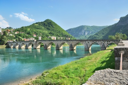 Famous bridge on the Drina in Visegrad, Bosnia and Herzegovina, on a hot summer day.