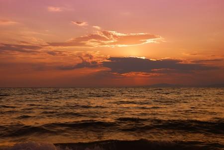 Orange and pink twilight over Paradisos beach in Sithonia, Halkidiki, Greece.