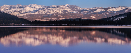 donner: Panoramic view on Donner Lake at sunset in the winter with Mt. Houghton and Mt. Rose in the background.